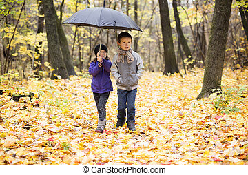 Happy children playing in beautiful autumn park