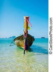 Boat on the beach ins Krabi, Thailand - Long tail boat....