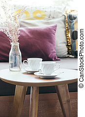 White coffee cup with flower vase on table decoration with...
