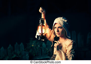 Curious Medieval Woman with Vintage Lantern Outside at Night...