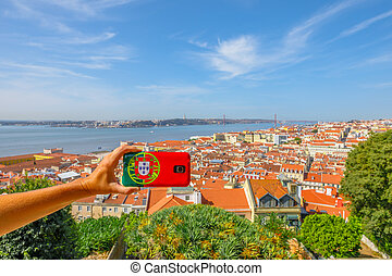 Lisbon pictures aerial - Woman takes photo of Lisbon skyline...