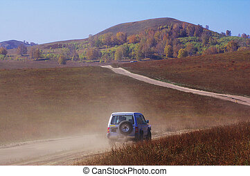 Off-road vehicle running in the grassland - Off-road vehicle...
