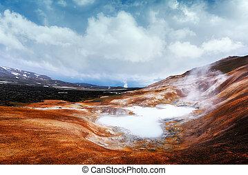 Acid hot lake in the geothermal valley Leirhnjukur, near...