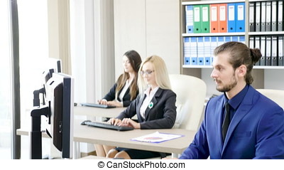 Team of business persons working in the office