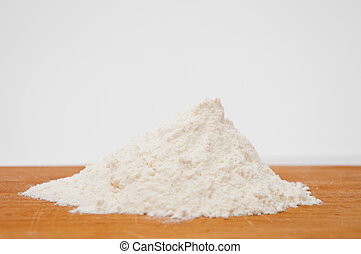 Flour - White wheat flour on a wooden table