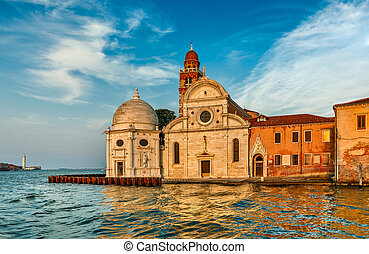 Church San Michele in Isola Venice Italy at background blue...