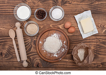 Food ingredients for dough a wooden kitchen board. Cake...
