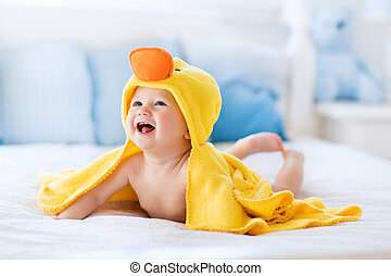 Cute baby after bath in yellow duck towel - Happy laughing...
