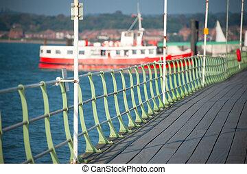 ferryboat - boardwalk railings leading to docked ferryboat