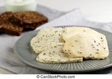 Estonian cheeses with cumin, dill, and garlic