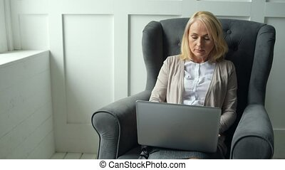 Busy woman concentrated on working