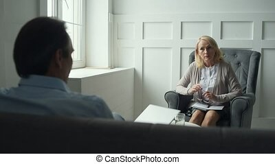 Professional psychologist giving consultation - Solving...