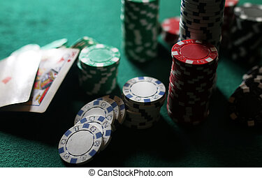 poker chips on the table - set of chips and cards on a green...