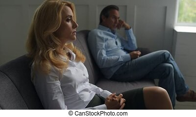 Sad couple sitting in psychologists office - No way out....