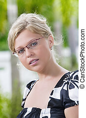 in glasses - Portrait of young pretty woman in summer...