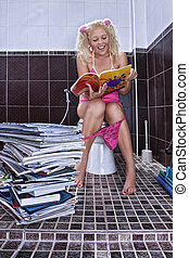 reading - Portrait of young woman reading magazine in toilet