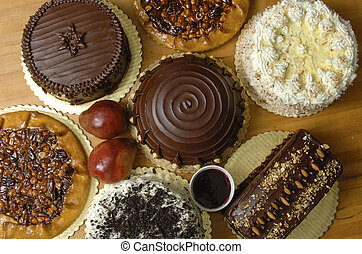 Several cakes on display on a bakery table