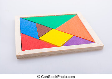 Pieces of a square tangram puzzle - Colorful pieces of a...