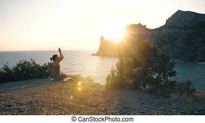 Woman do yoga at nature