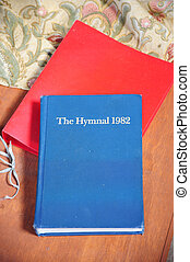 The hymnal. - The hymnal book located in a church.