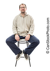 Confident male model on chair. Isolated on a white...