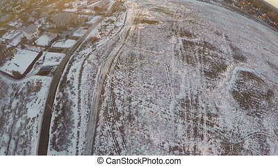 Flying over countryside with snowy fields, Russia - Aerial...