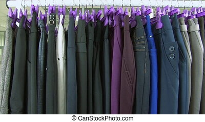 Old-fashioned ugly horrible womens clothing on rack in...