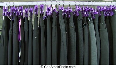 Old-fashioned ugly horrible women clothing on rack in...