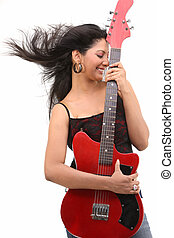 Happy Teenage girl with the guitar