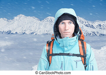 A man with backpack in winter the snowy mountains. Climber...