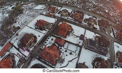 Flying over small winter town, Russia - Aerial view of...