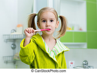 Dental care - child girl cleaning her teeth