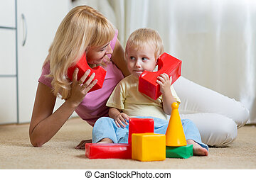 cute mother and child boy role playing together at home -...