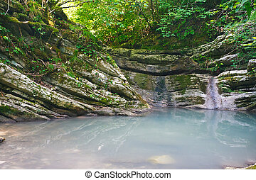 Beautiful mysterious lake among southern jungle forests -...