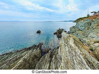 Summer morning rocky coast (Chalkidiki, Greece). - Summer...
