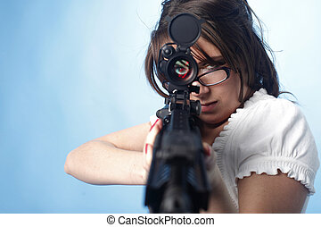 Sexy woman with assault rifle - Sexy woman aiming an assault...