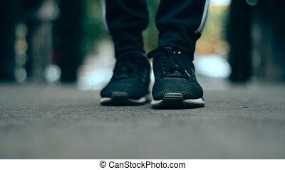girl in sports wear walks in the city
