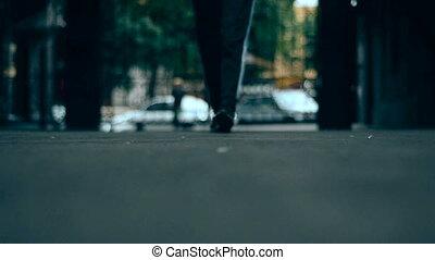 woman in sports wear walks in the city
