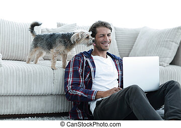 successful guy and his favorite pet in a cozy living room. -...