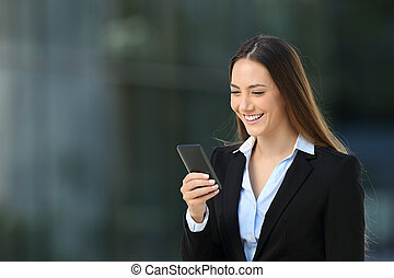 Smiley executive using a mobile phone on the street - Single...