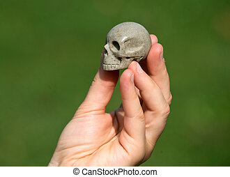 Sarsen stone skull from Avebury sacred site in young woman's...