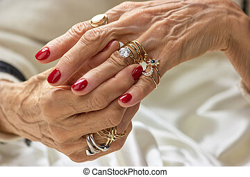 Female hands with golden rings. Senior woman hands with...