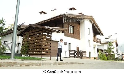 business man on a background of a chalet, a house in the...