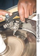 Diamond cutter: facetting of gem - Diamond cutter hands...