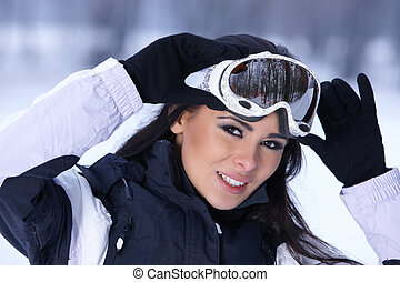 Beauty on snowy outdoors - Beautiful woman wearing goggles...