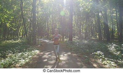 Young fitness woman running at forest trail - Young fitness...