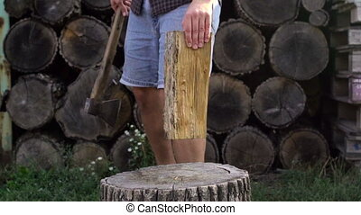 Man chopping wood with axe, slow motion shoot - Man chopping...