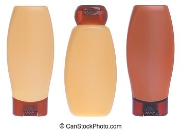 Shampoo and conditioner bottles - yellow and brown shampoo...