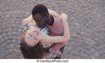 kissing of interracial happy couple - kissing interracial...