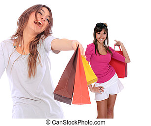 Happy shopping women. Isolated over white background